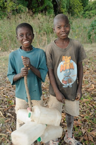 Haiti boys and water jugs